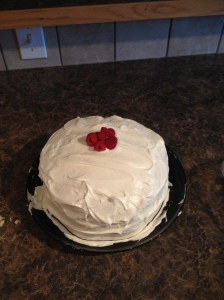 White Cake with Fripped Topping and Raspberry filling