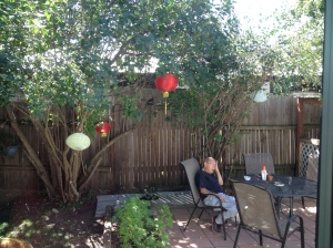Papa sitting under the Chinese lanterns.... Papa's trying to come to terms with Mac's suicide just like th rest of us