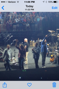 The band waving to the crowd at the end of the show